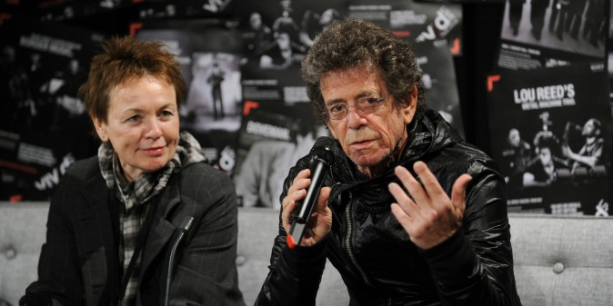 Legendary musician Lou Reed (R) and his