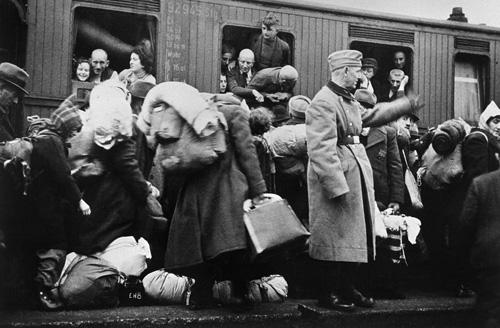 german-jews-from-westphalia-awaiting-deportation-by-train-to-riga